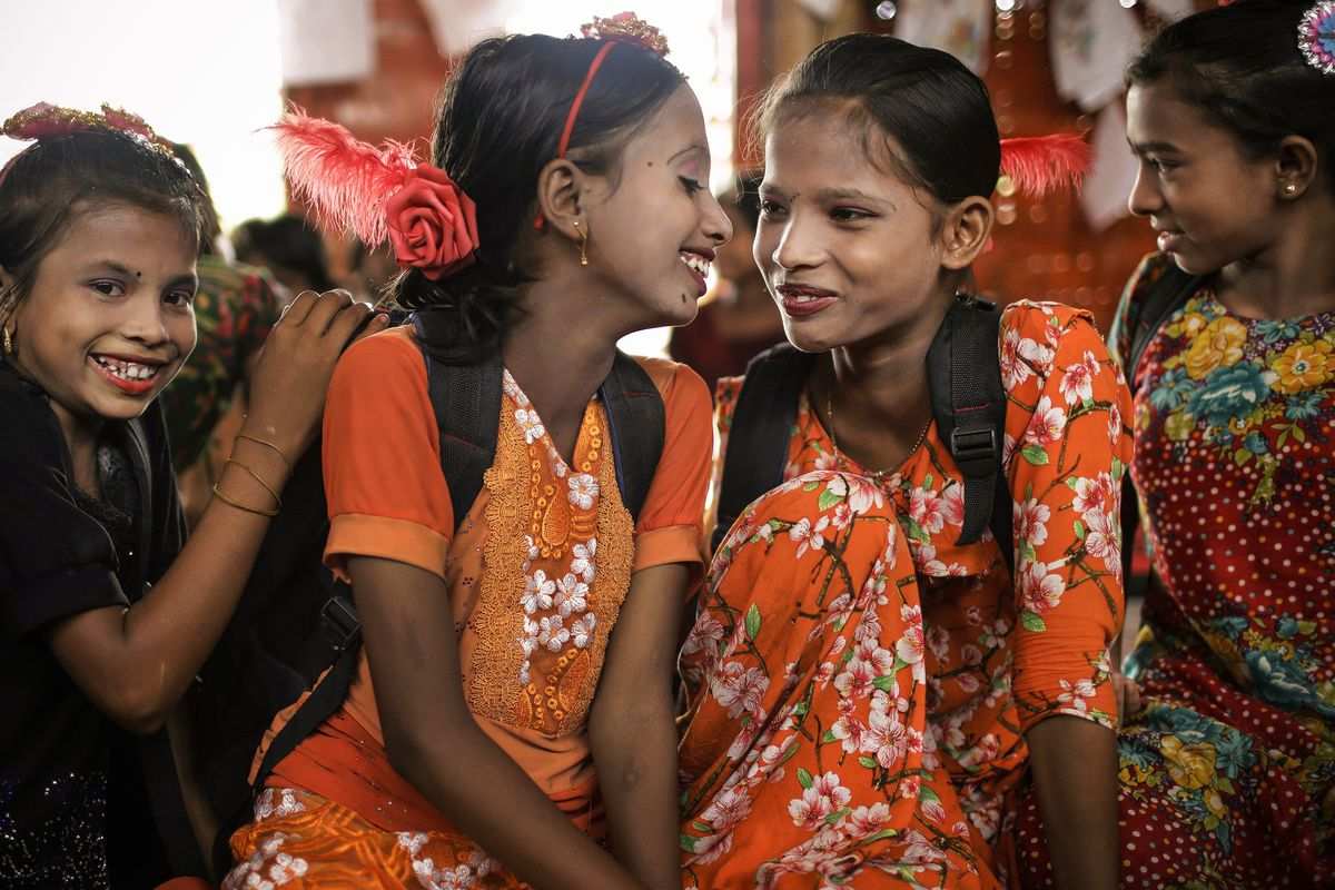 June 27: Ranjeda, 9, Rumana, 10, Minajan, 10 and Wisma Bi Bi, 12, all Rohingya refugees smile during class in the Chakmarkul refugee camp in Bangladesh. Read More. (Wong Maye-E/AP)