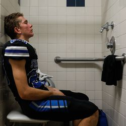Stansbury's Dylan Hamilton closes his eyes in the shower as he prepares for a high school football game against Tooeleat Stansbury High School in Stansbury Park on Friday, Sept. 17, 2021.