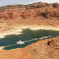 Boats are docked at Dangling Rope Marina on Lake Powell Friday, June 21, 2013. There has been debate on whether recreation areas and national parks in Utah should be opened and run by the state during the federal government shutdown.