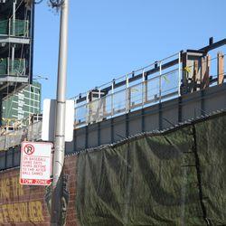 4:08 p.m. The back fence along the left-field bleachers -