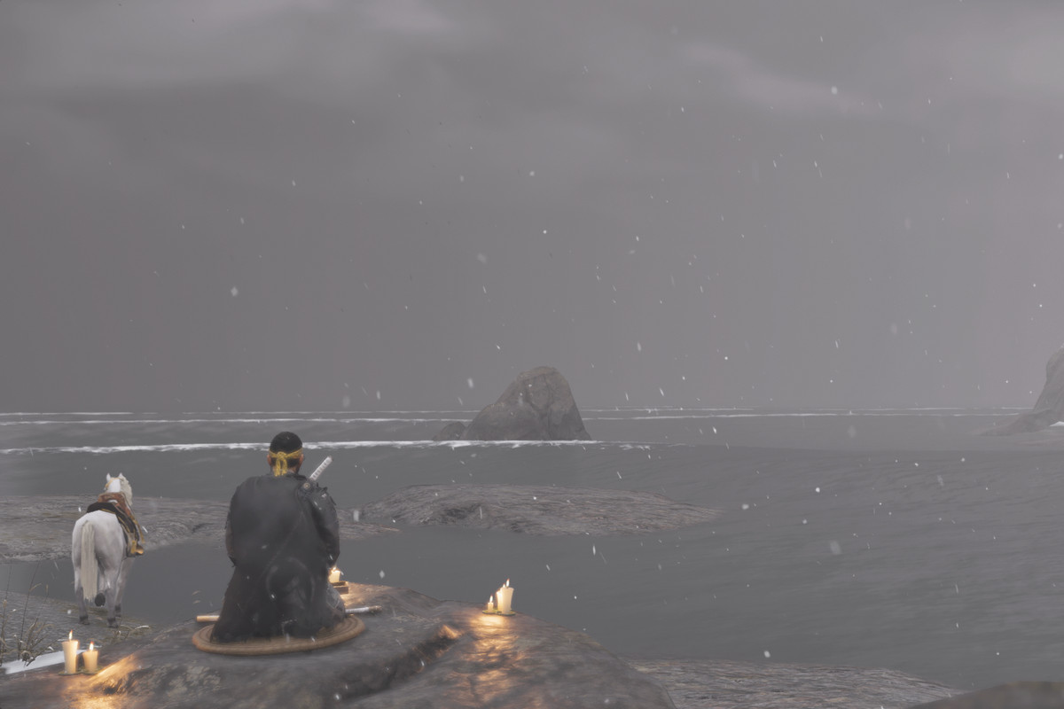 The main character of Ghost of Tsushima and sits and writes a haiku