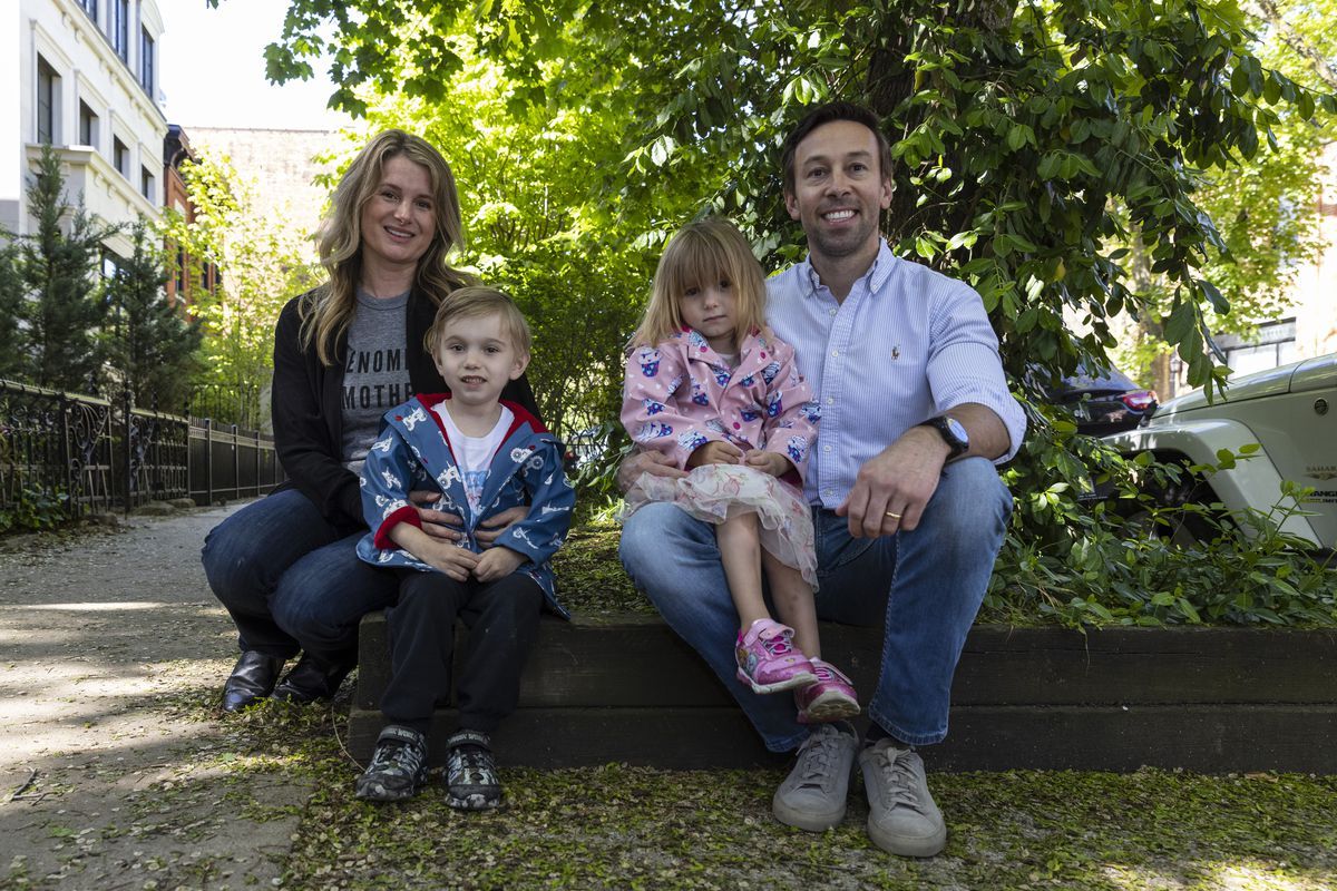 From left to right, Frida Brooks, Elliot, Alice and Todd Brooks pose for a portrait outside their home in Sheffield Neighbors, Wednesday, May 12, 2021.