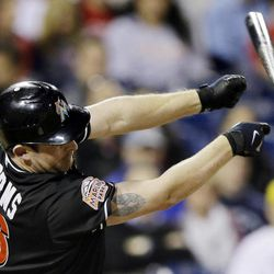 Miami Marlins' Austin Kearns loses his bat swinging at a strike in the eighth inning of a baseball game against the Philadelphia Phillies, Monday, Sept. 10, 2012, in Philadelphia. Philadelphia won 3-1.