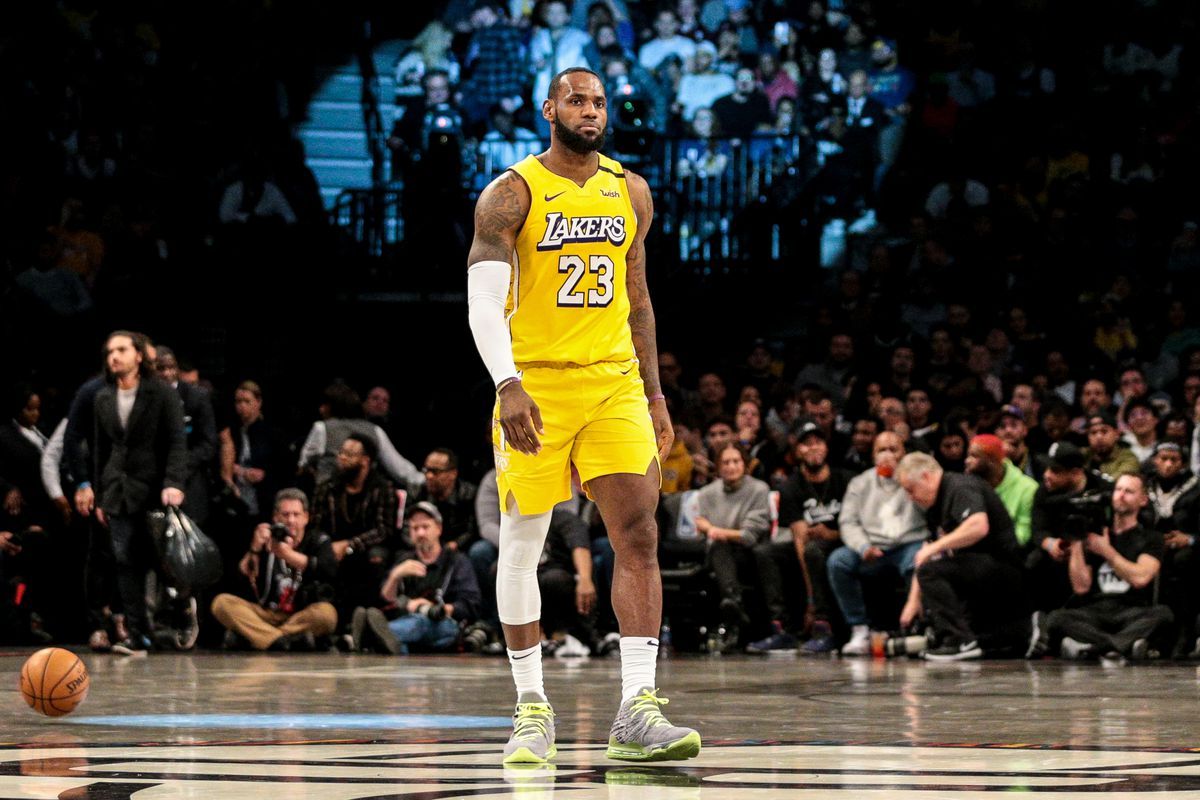 Los Angeles Lakers forward LeBron James walks on the court during a time out in the second half against Brooklyn Nets at Barclays Center.