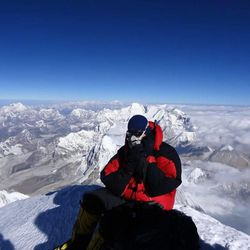 A climber named Chris Longacre, from Alaska, sits atop Mount Everest on May 19, 2013.