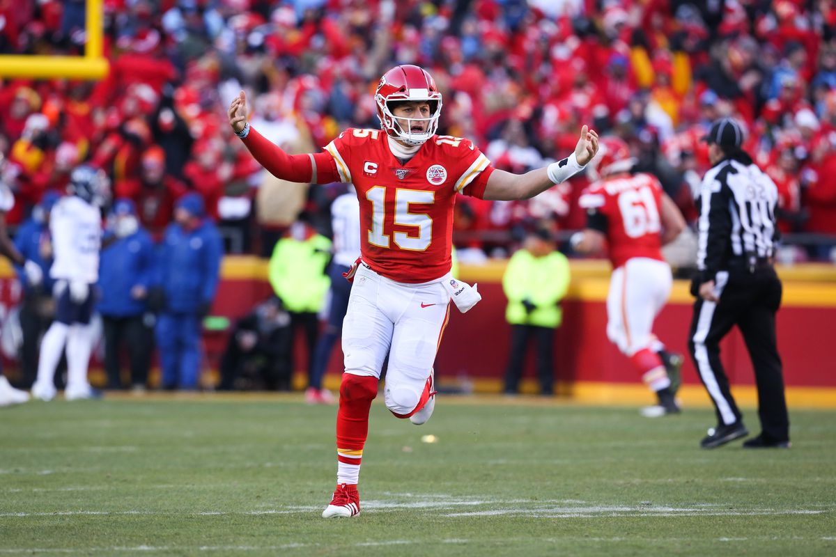 Kansas City Chiefs quarterback Patrick Mahomes raises his arms in celebration after completing a 20-yard touchdown pass to wide receiver Tyreek Hill in the second quarter of the AFC Championship game between the Tennessee Titans and Kansas City Chiefs on January 19, 2020 at Arrowhead Stadium in Kansas City, MO.