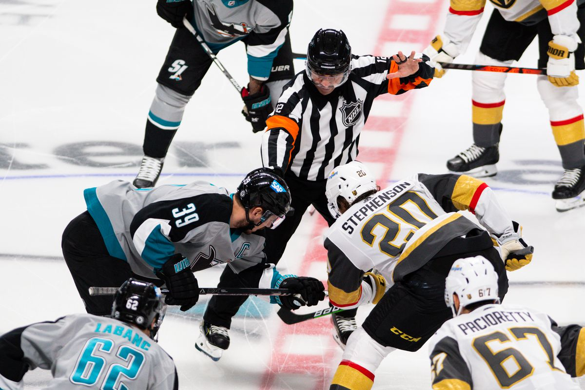San Jose Sharks center Logan Couture (39) and Vegas Golden Knights center Chandler Stephenson (20) get set for the puck drop during the NHL hockey game between the Vegas Golden Knights and the San Jose Sharks on March 6,2021 at SAP Center in San Jose,CA