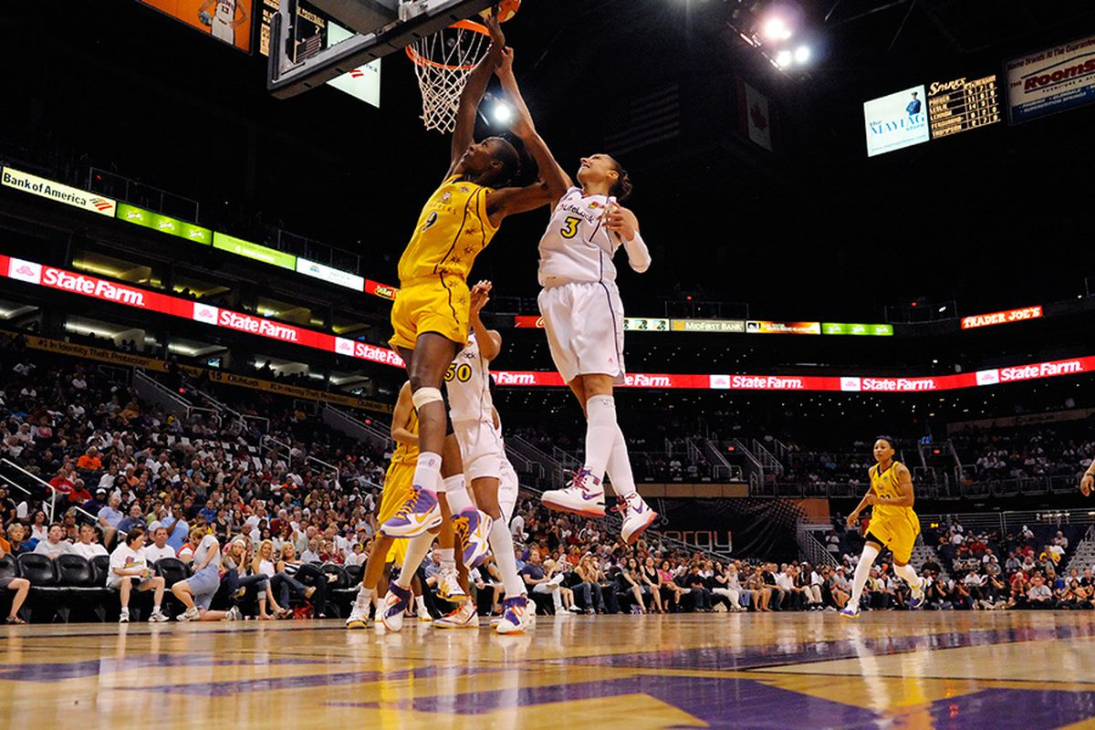 Diana Taurasi blocks Lisa Leslie's shot attempt in the Mercury's 85-74 win over the Sparks. <em>Photo by Max Simbron</em>