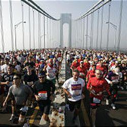 Some of the New York City Marathon's 37,516 participants fill the upper level of the Verrazano Bridge.