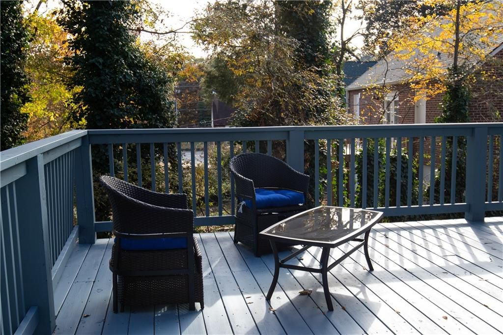 Deck with two chairs and coffee table.