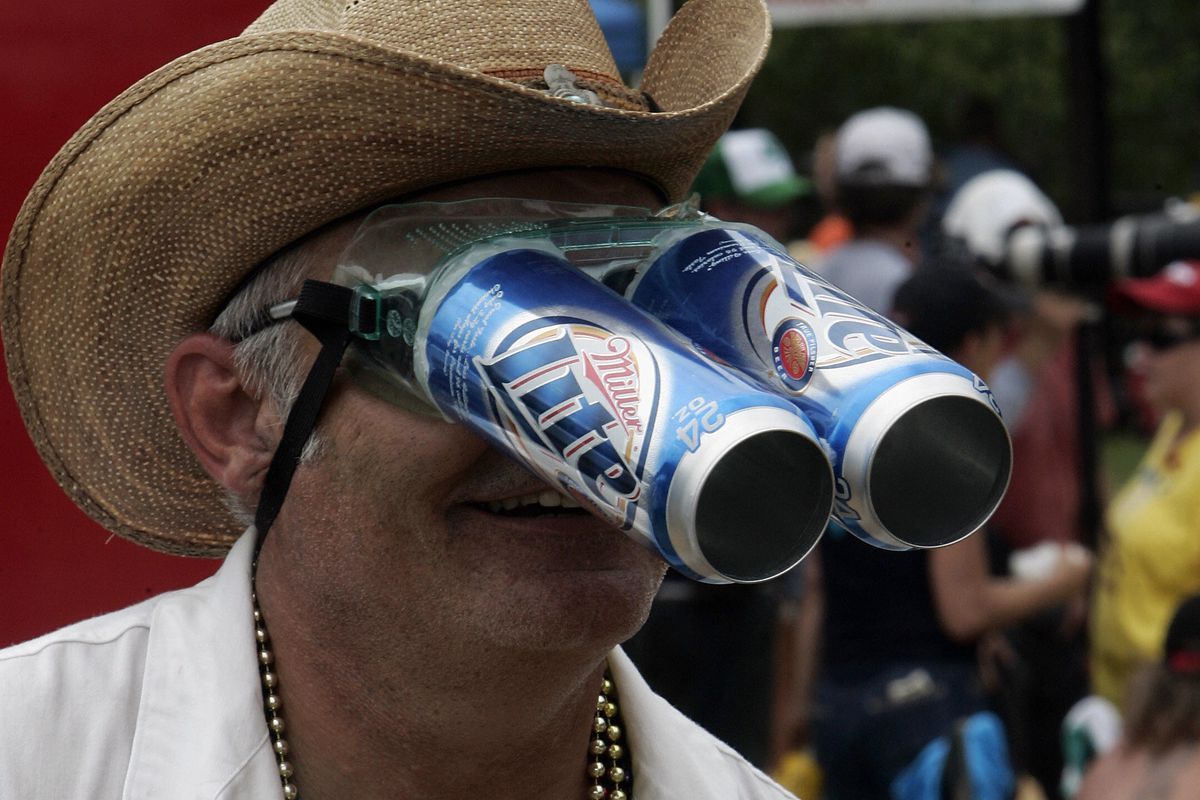 A reveler wears his homemade beer can go...
