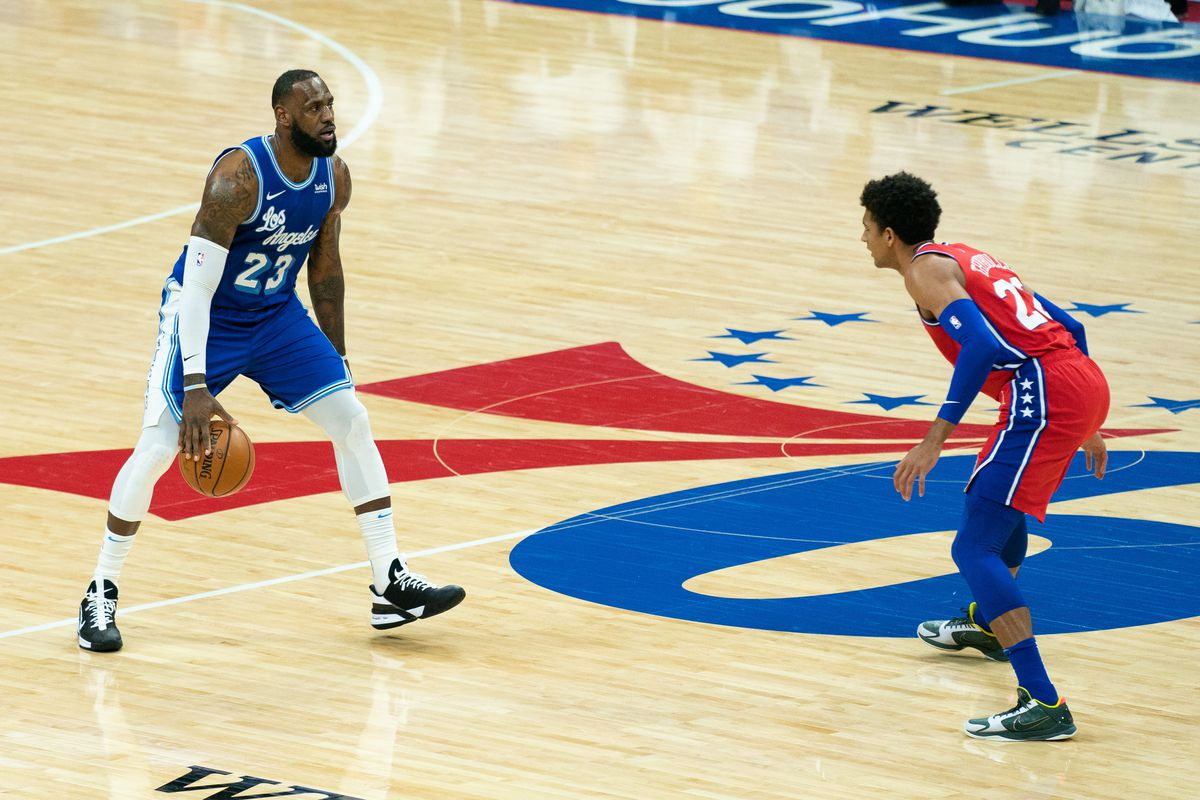 Los Angeles Lakers forward LeBron James (23) dribbles against Philadelphia 76ers guard Matisse Thybulle (22) during the first quarter at Wells Fargo Center.
