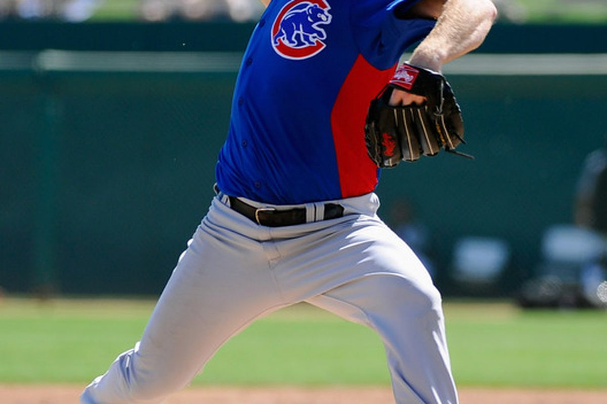 Ryan Dempster of the Chicago Cubs throws a pitch during a spring training baseball game at Camelback Ranch in Glendale, Arizona.  (Photo by Kevork Djansezian/Getty Images)