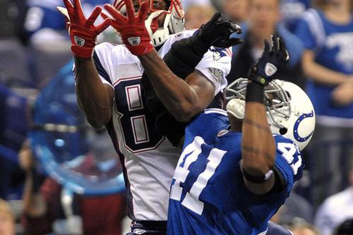 <em>Third arm's the charm.  Randy Moss catches the ball - and Antoine Bethea - for a touchdown.</em>