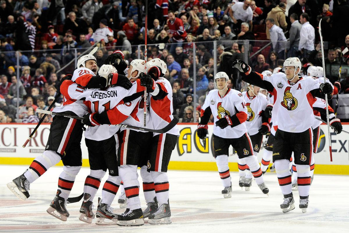 The Senators celebrate letting Craig Anderson do all the work for them. Not pictured: Craig Anderson, because he was too busy doing all the work. (Photo by Richard Wolowicz/Getty Images)