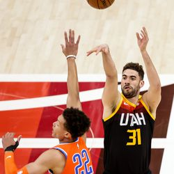 Utah Jazz forward Georges Niang (31) shoots over Oklahoma City Thunder center Isaiah Roby (22) during the game at Vivint Smart Home Arena in Salt Lake City on Tuesday, April 13, 2021.