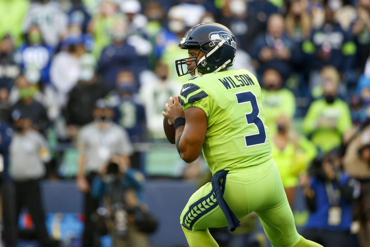 Seattle Seahawks quarterback Russell Wilson (3) looks to pass against the Los Angeles Rams during the first quarter at Lumen Field.