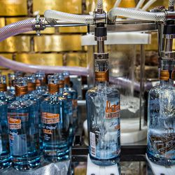 Bottles are filled with vodka during bottling day at Old 4th Distillery.