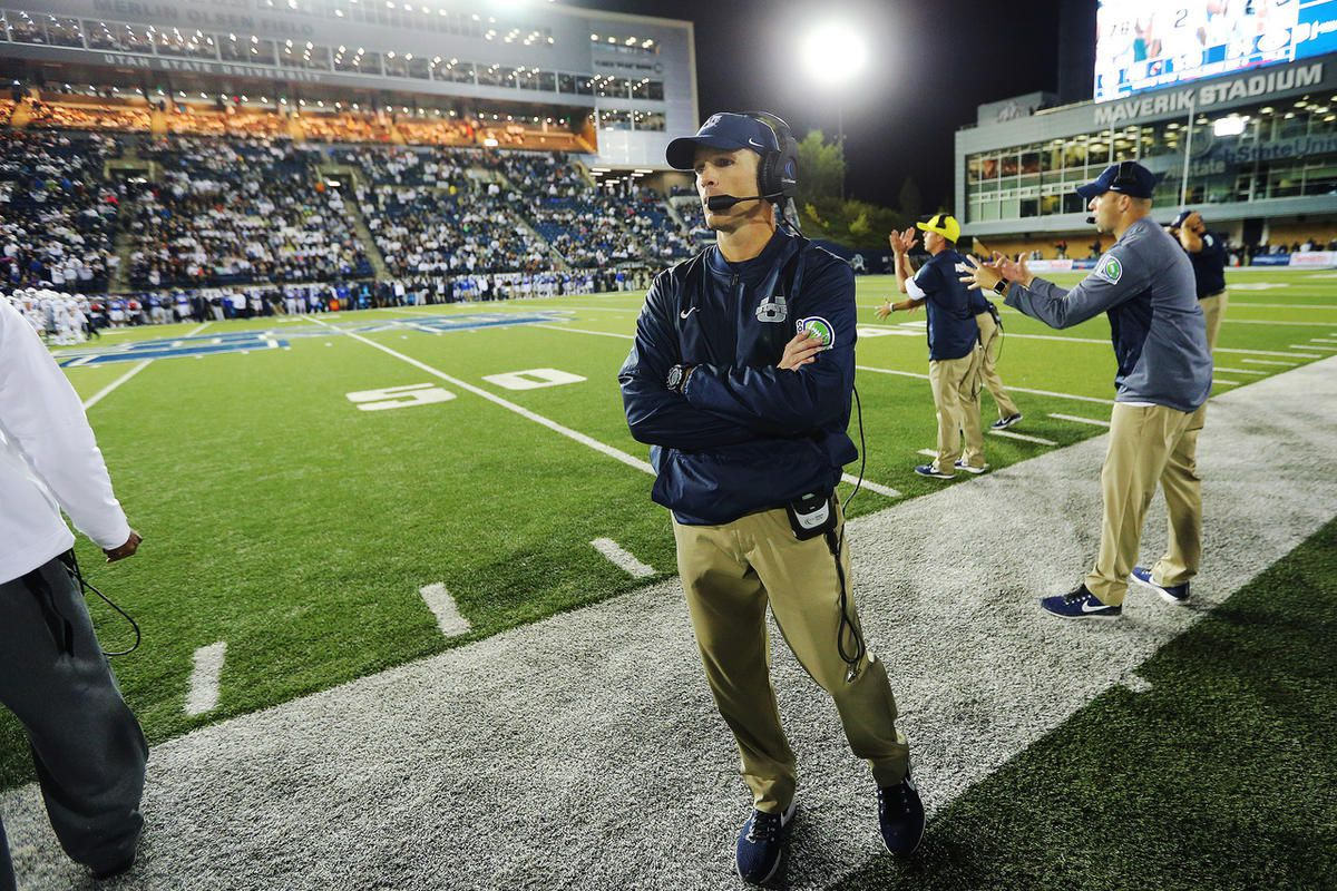 Utah State Aggies head coach Matt Wells looks down his sideline as time ticks down in the fourth quarter as USU goes on to defeat BYU 40-24 at Maverik Stadium in Logan Utah on Friday, Sept. 29, 2017.