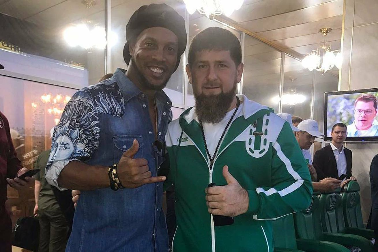 Soccer star Ronaldinho poses with Chechen leader believed to be purging gays