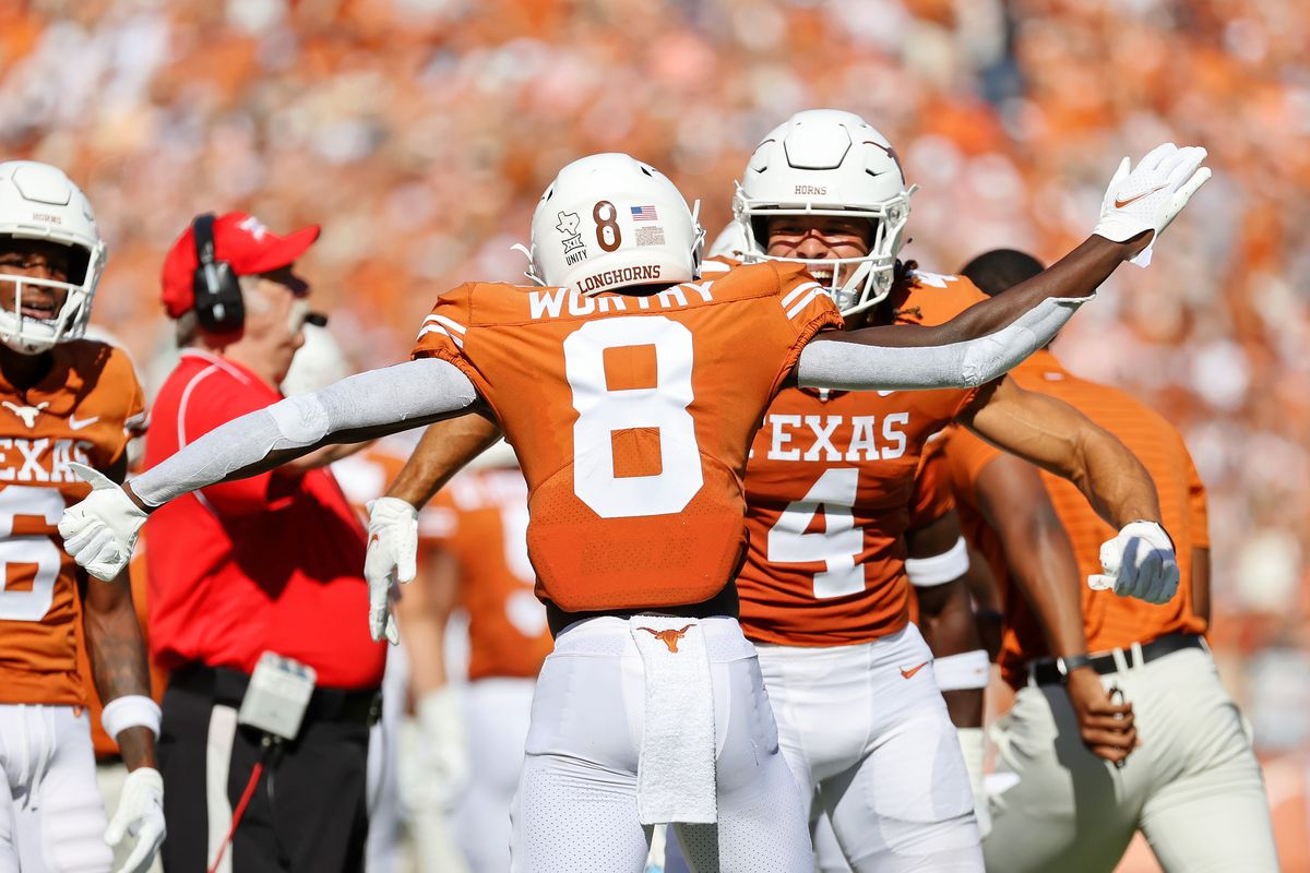 Texas Longhorns wide receiver Xavier Worthy (8) celebrates with wide receiver Jordan Whittington (4) after scoring a touchdown against the Oklahoma Sooners during the first quarter at the Cotton Bowl.