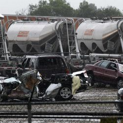 Destroyed vehicles sit in a Kenworth trailer lot after a tornado that swept through the area toppling many of the trailers on the lot Tuesday, April 3, 2012, in Lancaster, Texas. Tornadoes tore through the Dallas area Tuesday, peeling roofs off homes, tossing big-rig trucks into the air and leaving flattened tractor trailers strewn along highways and parking lots.