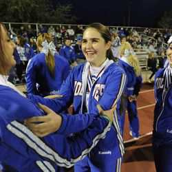 Kennedy Hansen, center, has fun laughing with Jaycee Gochis, left, and Kallie Edwards as the cheer squad was on hand for the Fremont at Viewmont football game on Wednesday, Oct. 16, 2013, in Bountiful. Kennedy recently died of juvenile Batten disease.