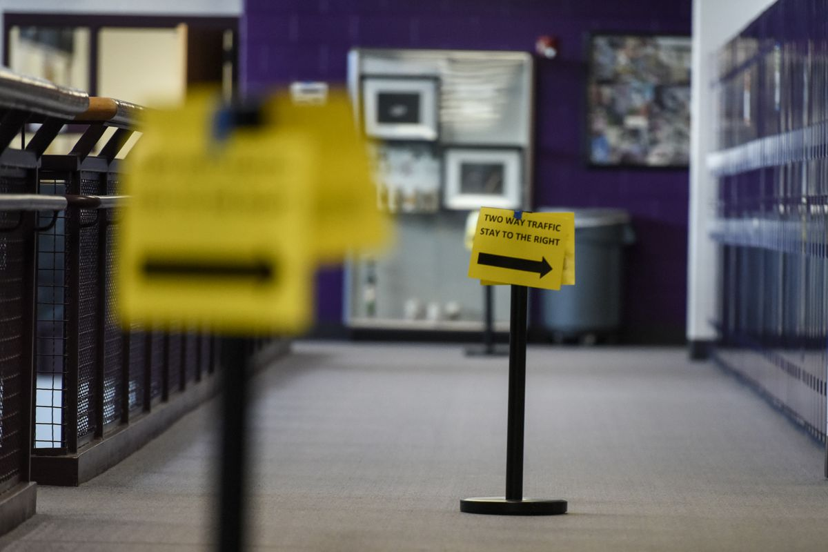 Sign in a school hallway asks people to stay to the right as a COVID precaution.