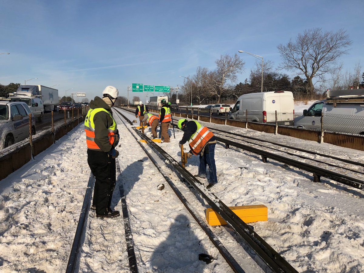 Chicago Transit Authority crews work to repair a rail malfunction that caused major delays on the Blue Line near the Forest Park station on Friday, Feb. 1, 2019. | CTA