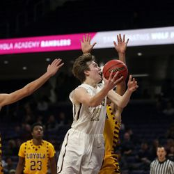 St. Ignatius's Derek Dingens (22) scores against Loyola's Quinn Pemberton (11) in their 56-46 loss at Northwestern University in Evanston, Friday, February 8, 2019.   Kevin Tanaka/For the Sun Times