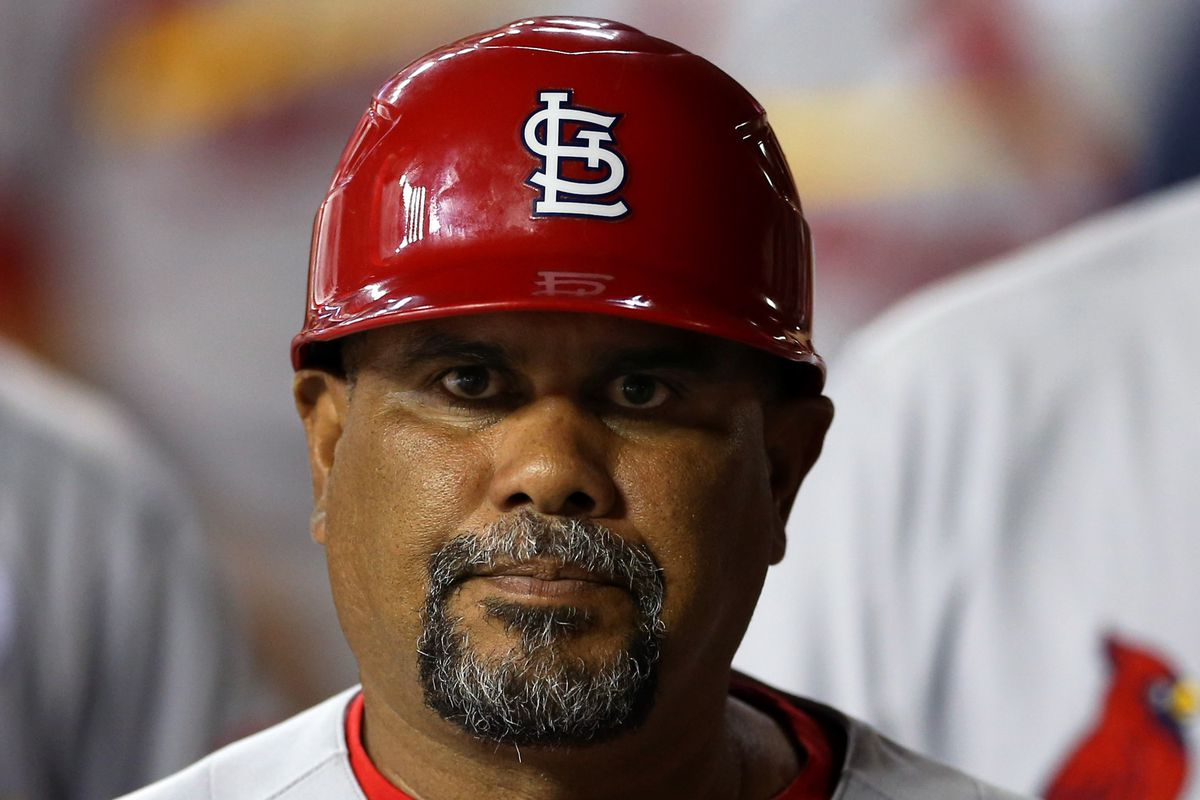 Imagine this mug staring into your soul from the dugout.
