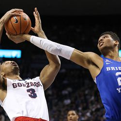 Gonzaga Bulldogs forward Johnathan Williams (3) and Brigham Young Cougars forward Yoeli Childs (23) battle for a rebound as BYU and Gonzaga play in an NCAA basketball game in the Marriott Center in Provo on Saturday, Feb. 24, 2018.