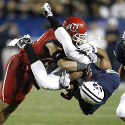Utah Utes linebacker Chaz Walker (32) slams Brigham Young Cougars wide receiver Ross Apo (11) to the ground as the University of Utah and Brigham Young University play football Saturday, Sept. 17, 2011, in Provo, Utah.