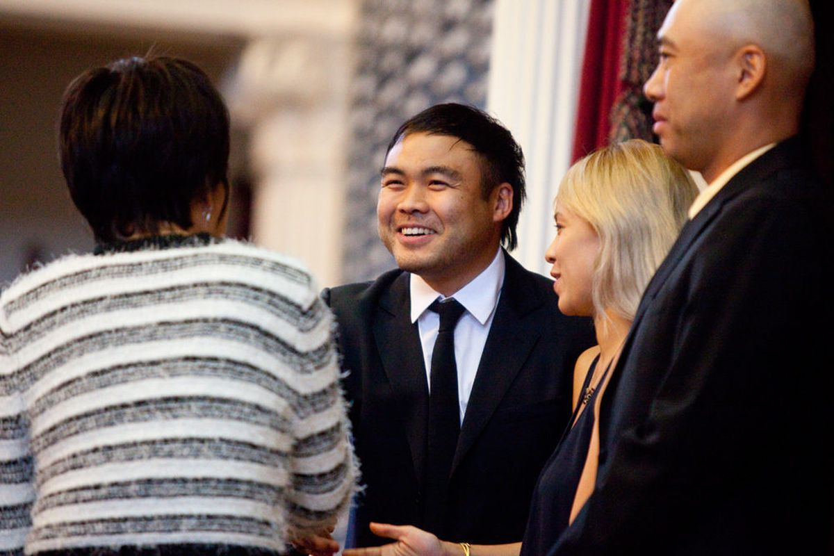 """Paul Qui shakes hands with Rep. Angie Chen Button, alongside Deana """"East Side Queen"""" Saukam and his ESK chef-partner Moto Utsonomiya."""