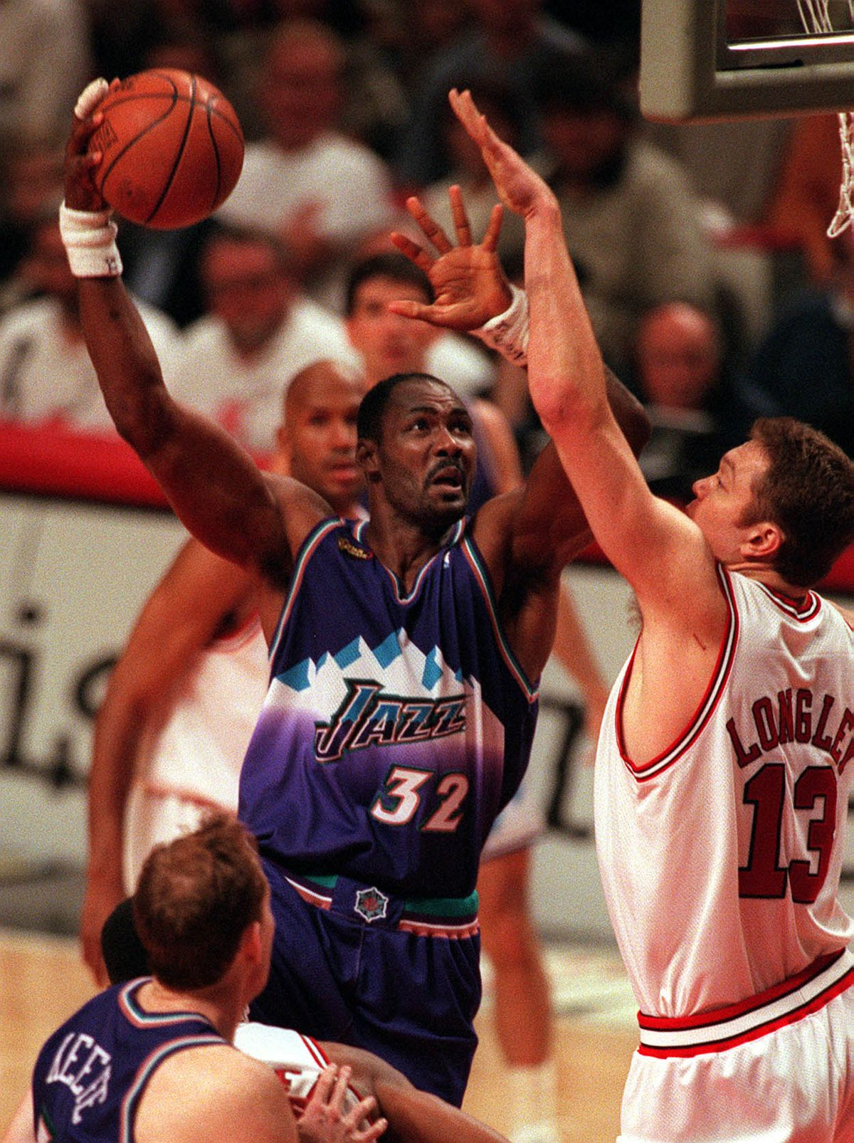 Karl Malone shoots over Luc Longley during the NBA Finals in Chicago.