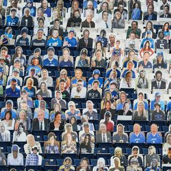 Photos of Brigham Young Cougars fans fill the stands during an NCAA football game at LaVell Edwards Stadium in Provo on Saturday, Oct. 31, 2020.
