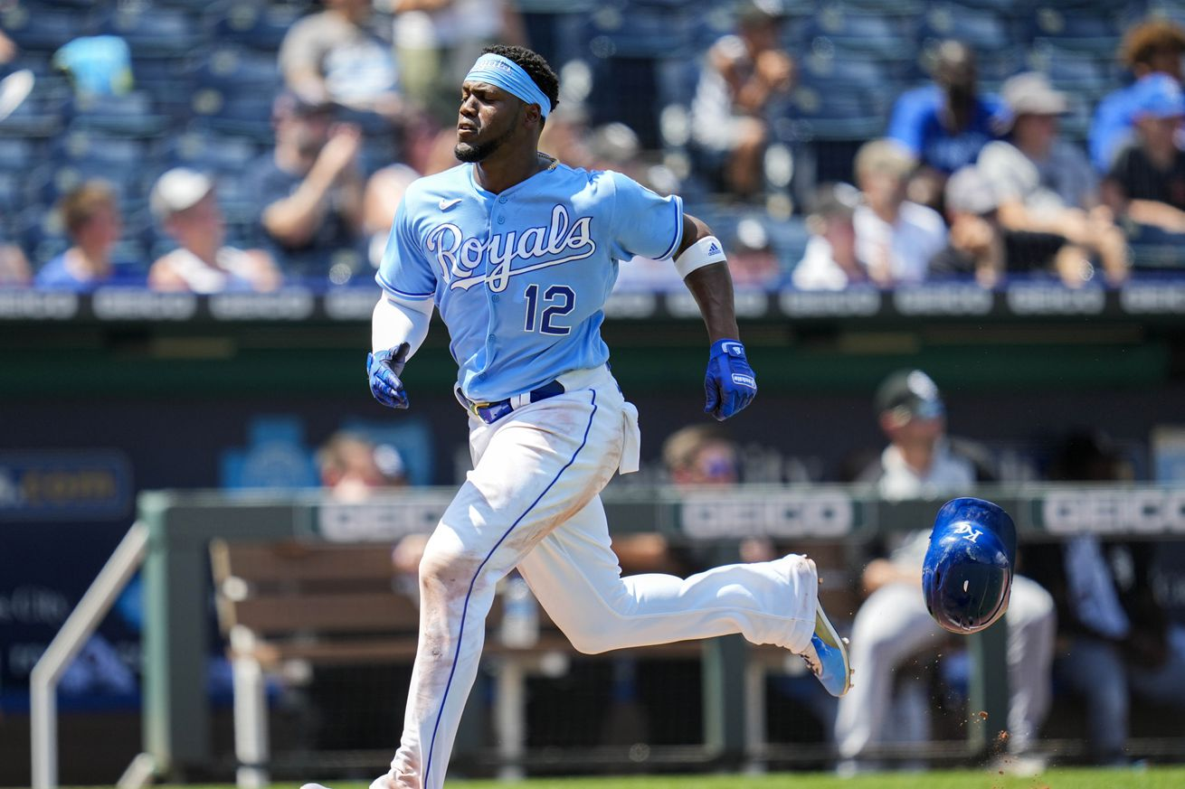 Kansas City Royals right fielder Jorge Soler (12) loses his helmet on his way to score against the Chicago White Sox during the fifth inning at Kauffman Stadium. Mandatory Credit: Jay Biggerstaff