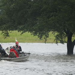 Rescuers transport evacuees during Tropical Storm Harvey in Houston on Tuesday, Aug. 29, 2017.