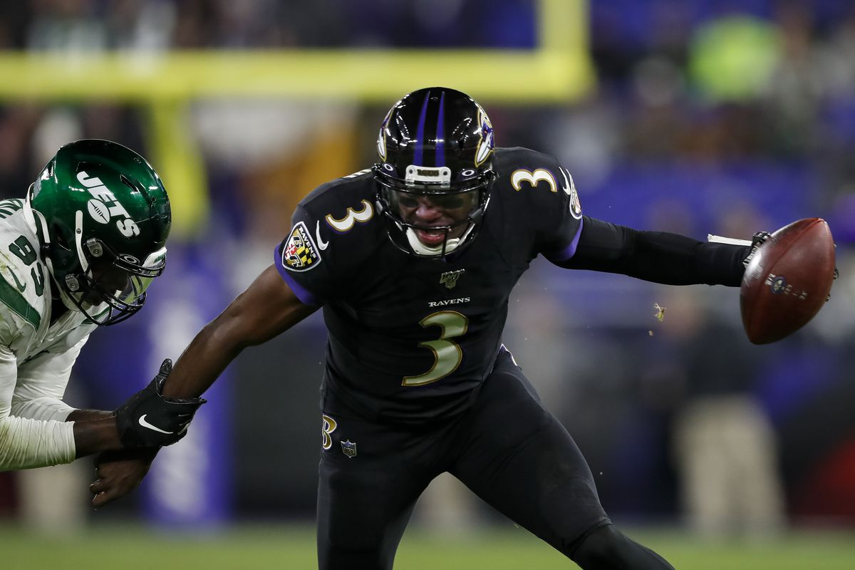 Robert Griffin III of the Baltimore Ravens scrambles as Tarell Basham of the New York Jets defends during the second half at M&T Bank Stadium on December 12, 2019 in Baltimore, Maryland.