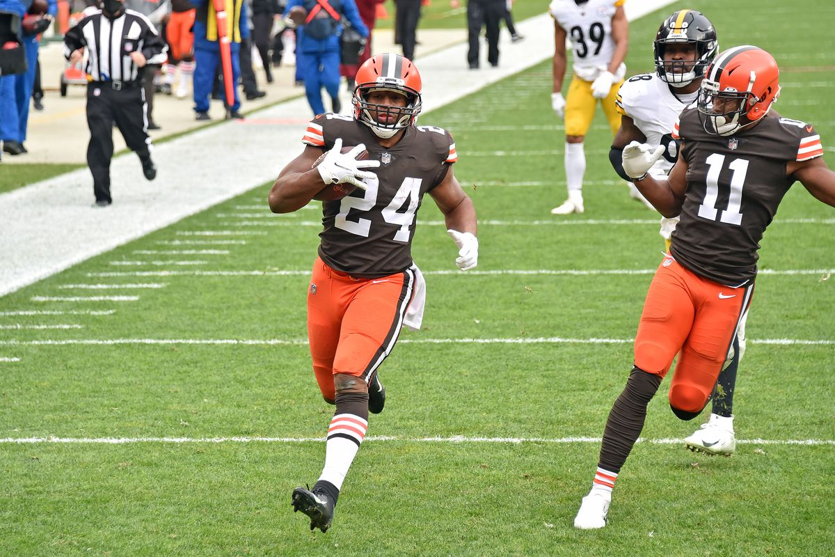 Nick Chubb #24 of the Cleveland Browns runs in a touchdown during the first quarter against the Pittsburgh Steelers at FirstEnergy Stadium on January 03, 2021 in Cleveland, Ohio. The Browns defeated the Steelers 24-22.