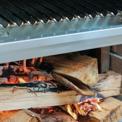 The grill raises and lowers as need be depending on what's being cooked.