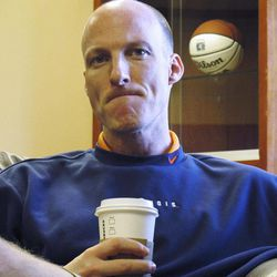 ADVANCE FOR WEEKEND EDITIONS, APRIL 7-8  - In this photo taken April 5, 2012, new Illinois basketball coach John Groce holds a cup of coffee as he talks about his job during an interview with the Associated Press in his office in Champaign, Ill. Groce is taking over a 17-15 team that skidded badly at the end of the season. Even worse, the team's best player, 7-1 center Meyers Leonard, is leaving for the NBA.