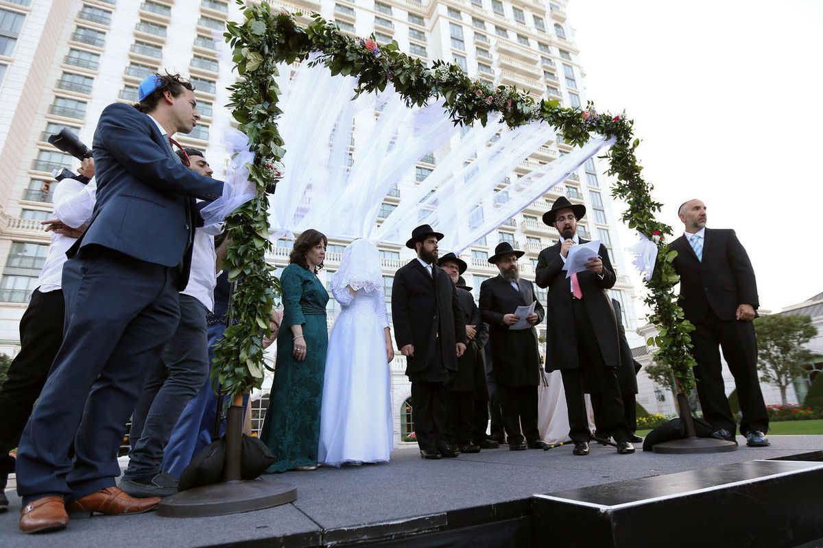 Rabbi Avremi Zippel speaks during a traditional Chabad Lubavitch Jewish chupah wedding ceremony for his sister Chaya Zippel and Rabbi Mendy Cohen at the Grand America Hotel in Salt Lake City on Monday, Sept. 12, 2016.