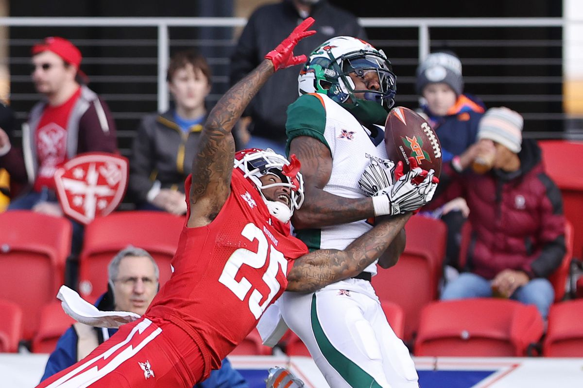 DC Defenders cornerback Desmond Lawrence breaks up a pass intended for Seattle Dragons wide receiver Alonzo Moore in the second quarter during a XFL football game at Audi Field.