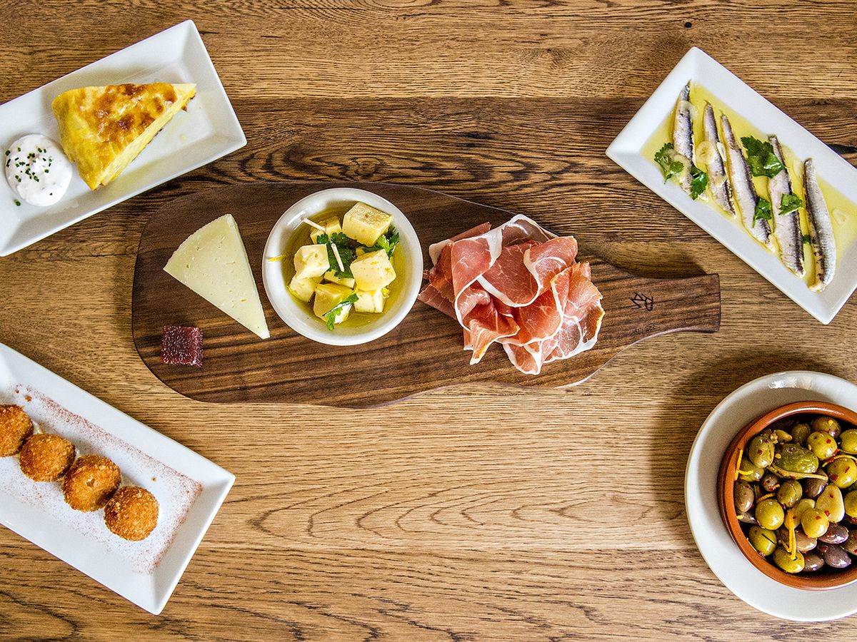 Olives, anchovies, croquettes, and other tapas
