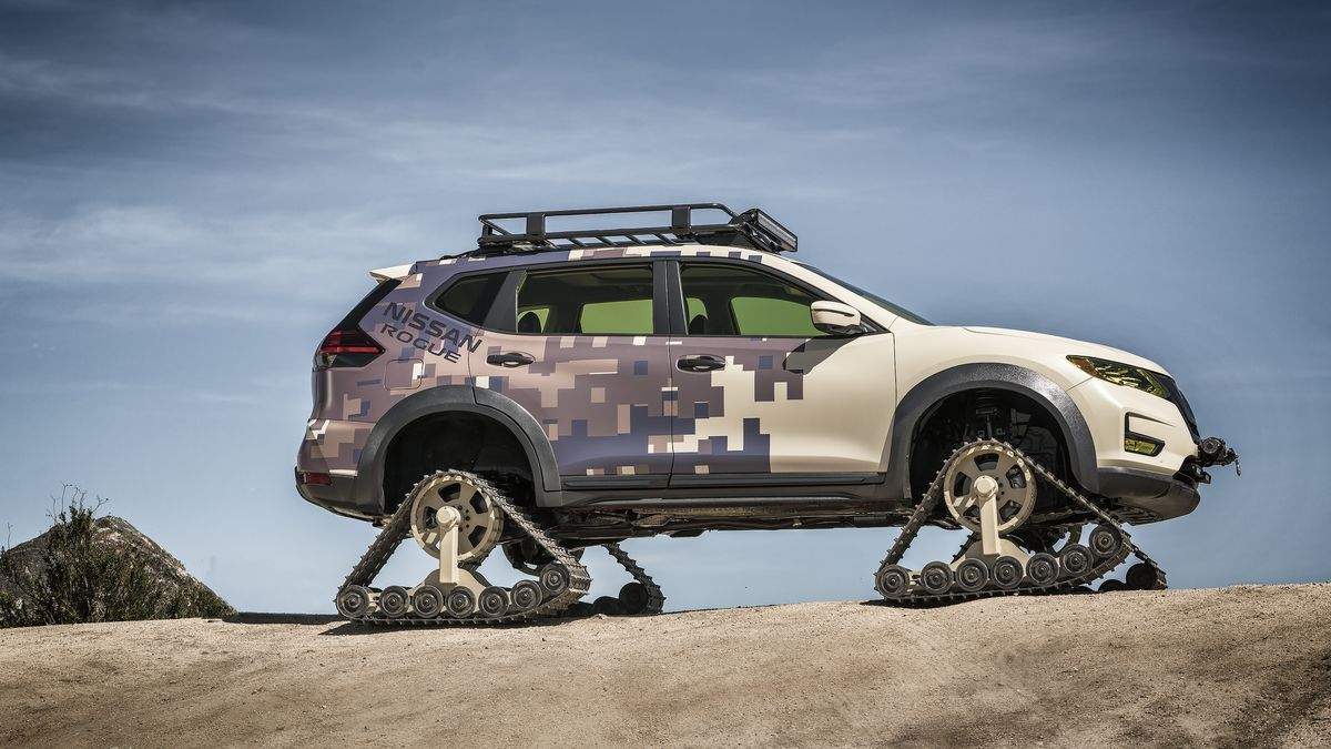 A nissan rogue with tank treads for wheels