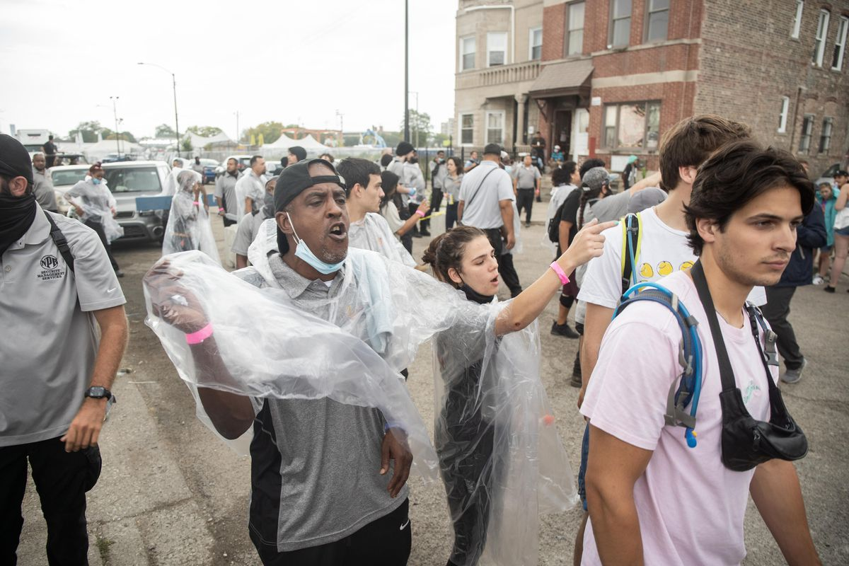 Security urges Spring Awakening Musical Festival: Autumn Equinox festival goers to evacuate due to severe weather near the Addams/Medill Park in the University Village neighborhood, Saturday afternoon, October 2, 2021.