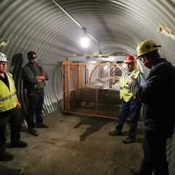 Dan Baker, CEO and president of the Bronco Utah Mine, right, talks with others in the reclaimed coal tunnel conveyor belt area at the mine near Emery on Wednesday, March 29, 2017.