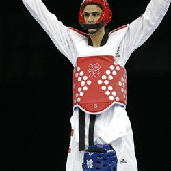 Australia's Safwan Khalil, top, reacts after his fight against Mexico's Diego Garcia de Leon in men's 58-kg taekwondo competition at the 2012 Summer Olympics, Wednesday, Aug. 8, 2012, in London. (AP Photo/Ng Han Guan)