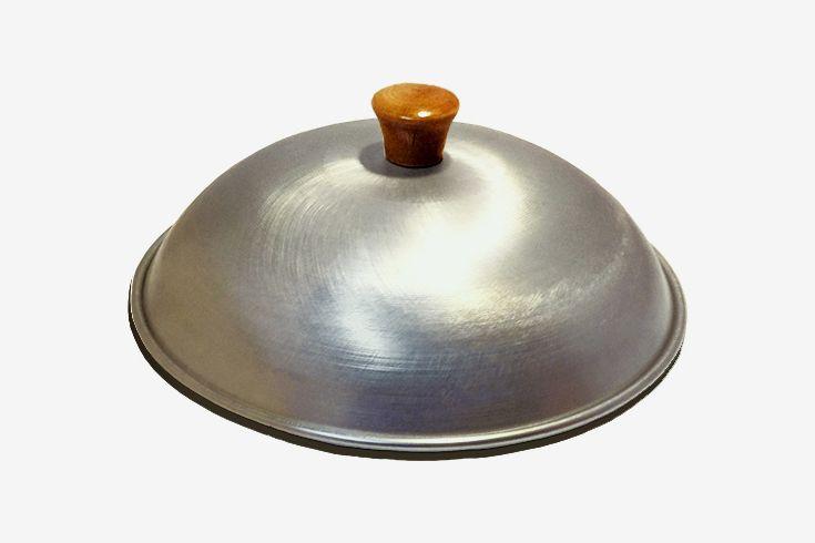 Domed wok lid.